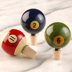 Whether you're looking for a great gift for a guy, or just want to keep your wine corked in style, check out these pool ball wine stoppers from Knobstoppers. They're made from real billiard balls and look fantastic. Very cool for a bar area near a pool table or at your next billiards party!