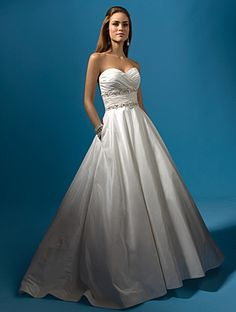 """TLC's """"Say Yes To The Dress: Atlanta"""" 2010 White Satin Wedding Dress with Pockets --- The show says the designer was Lazaro, but the design is very similar to Alfred Angelo Style #2119. I heart pockets. Not sure strapless and a big poufy A-line skirt would look good on me though. Something to consider!"""