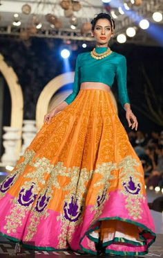 Heavy lehnga vd a plain blouse...can work vd a nice neckpiece