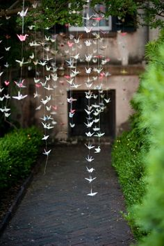 Paper cranes. Would be cool to hang these down the aisle to get married.