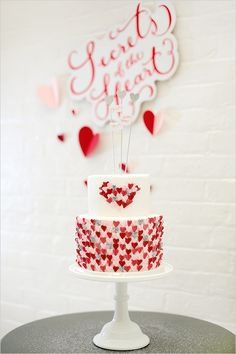 Wedding cake covered in pink, red and silver hearts
