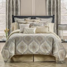An elegant medallion pattern in shades of gray and gold adorn the comforter and shams in this bedding set by Waterford. The bedskirt coordinates in solid gold with a subtle pebble texture. | Polyester
