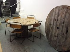 cable drum dining table    one side of huge cable drum and one smaller drum at base. seats 6-8.