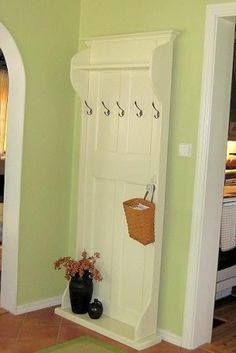 awesome! Old door turned coat rack! I love this because it's flat to the wall for small spaces. @ MyHomeLookBookMyHomeLookBook