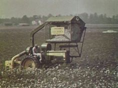 John Deere 430 with mounted cotton picker.