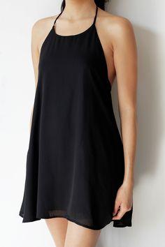 • 100% Polyester • Halter dress with tassel detail