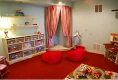 cool playroom with a great stage area for performing or quiet reading nook
