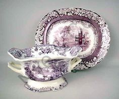 A STAFFORDSHIRE PLUM TRANSFER DECORATED OVAL PLATTER AND A SHAPED FOOTED HANDLED CENTER BOWL