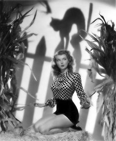 I gotta start posting these faster.  Too many great Halloween images I want to pin like this one with Lillian Wells.      Great minimalist art direction and fabulous glamour lighting.  And the wardrobe.  Love the high waisted shorts and the checkerboard shirt that accentuates the 40's bra.  You'll could poke your eye out with those things...