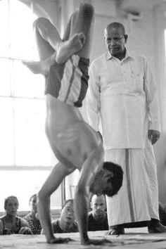 1990's: Pattabhi Jois teaching yoga with his grandson Sharath