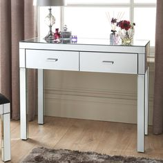 Florence Console Table. The Florence range boasts a sleek mirror design that is light reflecting to create the feel of space and light in your living room.