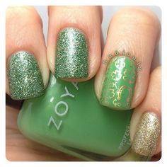 St. Patrick's day mani. Polishes used China Glaze This is Tree-mendous, Zoya Josie, and OPI My Favorite Ornament. Stamped using Cheeky Jumbo Plate 6 Happy Holidays in Maybelline Color Show Bold Gold.