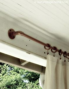 pvc pipe coated with copper spray paint. porch curtains..