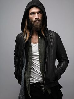 """I don't know who this is or what he's selling, but I'M BUYING IT!!!!  This is """"the look"""" I go for: Long hair, beard, black leather jacket, white t-shirt, jeans.   I'll bet he's got boots on and plays the guitar too..."""