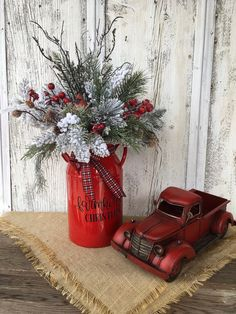 Farmhouse Christmas arrangement from my shop: Farmhouse Christmas Red Enamelware Floral Pitcher with Cardinal, Christmas Cardinal Enamelware Centerpiece, Holiday Arrangement Christmas Flower Arrangements, Christmas Greenery, Christmas Flowers, Christmas Centerpieces, Xmas Decorations, Christmas Floral Designs, Cowboy Christmas, Christmas Signs Wood, Country Christmas