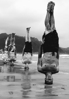boys | headstand | strong | upside down | blood rushing to the head | beach | summer fun | silly | vertical | black & white photography | sand | surf | ocean | www.republicofyou.com.au