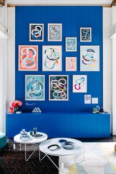 Love a good art wall! Dulux 'Mondrian Blue' and Kirra Jamieson art    The Design Files Open House (Hawthorn) via thedesignfiles.net