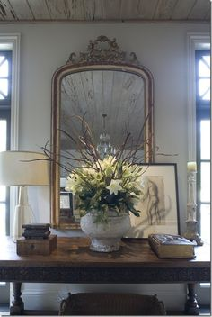 Miscellaneous - COTE DE TEXAS Foyer Decor compiled by a brass dainty mirror over a console table decked with frames, flowers and a lamp South Shore Decorating, Foyer Decorating, Interior Decorating, Decorating Ideas, Decorating Websites, French Decor, French Country Decorating, Beautiful Mirrors, Beautiful Homes