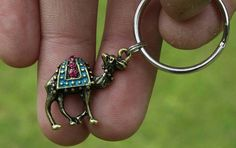 Check out this item in my Etsy shop https://www.etsy.com/listing/294195425/camel-keychain-boho-hippie-animal-desert