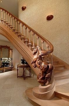 Staircase railing craftsmanship by master artist Jop Van Driel of TrapArt.  Gorgeous!