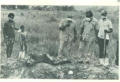 Arnaldo dos Reis Araujo (center) during the excavation of the graves of the victims whose bodies were burned before being buried (Source image: East Timor Provisional Government Archive)