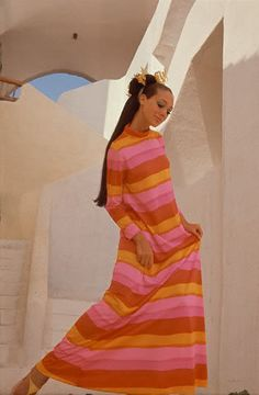 Marisa Berenson in a  in bright striped dress with turtleneck and long sleeves by Ferro.  Photo by Henry Clarke, c. 1967.