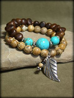 Two stretch bracelets beaded in a southwest style and perfect for your fall and winter accessories.    Picture jasper round gemstones that have a silver plated leaf and stone charm that dangle and then tiger ebony triangle wood beads together with round stabilized turquoise. I like the way these two look together...great natural earthy colors.    They measure 7 in diameter.    Look for more designs in my shop here:  stoneweardesigns.etsy.com