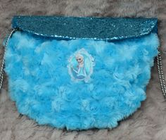 Frozen Elsa Inspired Girls Crossover Bag  https://www.etsy.com/uk/shop/Thimbles1?ref=hdr_shop_menu
