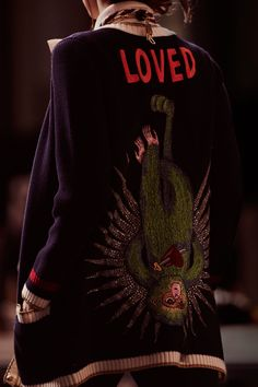 The back of a Gucci Spring 2017 cardigan featuring Fish's design.