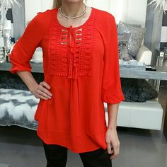 """'EMBER' tunic top NWT ❤When in doubt wear RED❤ Brand new with tags  Gorgeous and vibrant red top! Lovely details on the front. Breezy and loose fitted style.  Material 100% polyester Threaded Lace detailing on front 100% cotton Length approx 28"""" long in front and back, curves up on sides ( pic 3 side view) Tops"""
