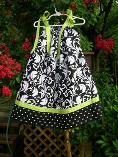 Love the fabrics and color combos in this cute pillowcase dress. Could be done in a knot dress too!