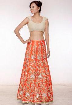 Sangeet Lehengas - Cream & Orange Lehenga | WedMeGood Cream Blouse & Orange Lehenga with Silver and Gold embroidery. Find more designs on wedmegood.com #wedmegood #lehenga #mehendi