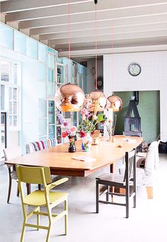 Ohhhh pretty dining room with Tom Dixon copper lights
