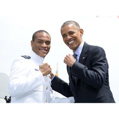 Who's got the power?! President Obama poses with another ensign at the U.S. Coast Guard Academycommencement.