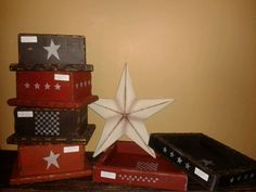 Booth555.com Stencil on checkerboards n star designs on plain boxes for a primitive theme