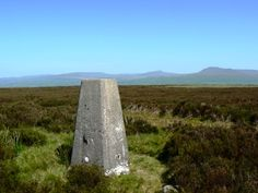 The trig point on Burn Moor in the Forest of Bowland looking to Whernside and Ingleborough.