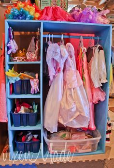 Old entertainment center into dress-up closet-----I'd make mine a little different, but this idea will get the wheels turning.  :)