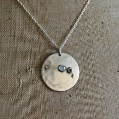 Aries Star Constellation | Honeybourne Jewellery * Bespoke. The pendant has a stamped Aries constellation, two 18ct gold beads mark 2 of the 4 stars, Opal and Sapphire stones mark the remaining 2 and are the birthstones of the partner and her sister (who very sadly passed away).