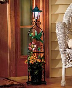 "With a solar lantern on top and vibrant colors toward the bottom, this plant stand will become the focal point of your porch or patio. When fully charged, the lantern stays lit for up to 8 hours. The stand breaks down for easy storage. 8-5/8"" dia. x 32""H"