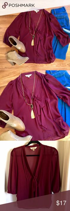 Burgundy chiffon tie neck blouse Burgundy maroon chiffon 3/4 quarter sleeve blouse, tie neck detail. Button down accents. Pleated neck. Roll sleeves. Perfect for fall! Beautiful color! Great to layer or wear as is. Dress up or down! OPEN TO OFFERS! DISCOUNTS ON BUNDLES! Listed as Francesca's for viewing purposes Francesca's Collections Tops Blouses