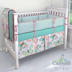 Crib bedding in Solid Teal, Bright Damask Butterflies, Kumari Garden Tarika, Solid Almond Pink. Created using the Nursery Designer® by Carousel Designs where you mix and match from hundreds of fabrics to create your own unique baby bedding. #carouseldesigns