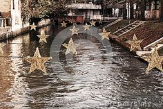 Star decorations for Christmas purpose, on Sile river, in Treviso city, in Veneto, Italy. Star Decorations, Christmas Decorations, Treviso Italy, Star Images, Purpose, River, Stock Photos, Stars, City