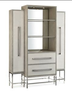 Zulu Stepped cabinet by John Richard  The stainless steel legs support the center section, which has two linen faced drawers, open display area and modern mirror back with touch lighting. The outside cupboards are set back and have linen faced doors. Stainless steel handles are fitted to the doors and drawers.