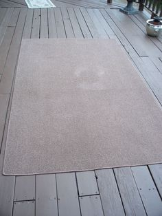 "I wanted to give my deck a bit of design while providing a more ""comfy"" feeling. So I bought a plain rug and using just one stencil, and created a spectacular r…"