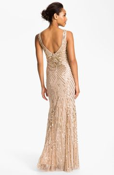 The perfect black tie gown, adorn with glistening sequins.