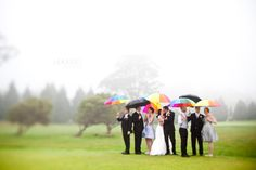 Photo Op: The wedding party with their colored umbrellas while the bride and groom hold their black and white umbrellas.