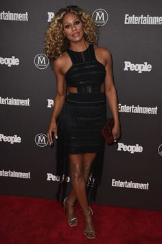 Laverne Cox Cutout Dress - Laverne Cox looked foxy in a form-fitting black RVN cutout dress with silver trim and a fringed skirt at the Entertainment Weekly and People New York Upfronts.