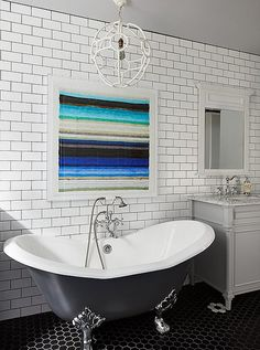 Above the bath: Don't let a little tilework stop you from creating a museum-worthy focal point above the tub.