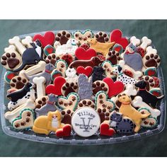 """""""One of two cookie platters I made for the grand opening of Village Veterinary Care Clinic in Norman, OK. My niece has helped them get the clinic up and…"""""""