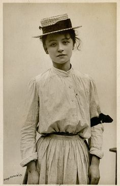 vintage postcard 1906  The black armband indicates she has recently lost a loved one.  Her expression is poignant.